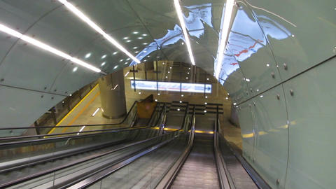 Modern escalator moving down, carrying passengers to underground subway station Footage