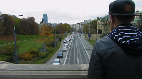 Man standing on bridge looking down at passing cars, intending to commit suicide Footage
