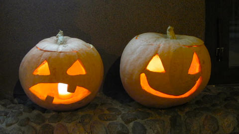 Spooky pumpkins carved into jack-o-lanterns reminding about All Saints Day Footage