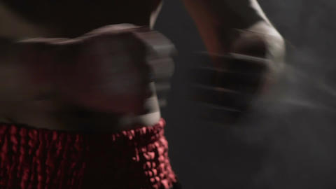 Close-up of male boxer hands clapping together with talcum powder, slow-motion Footage