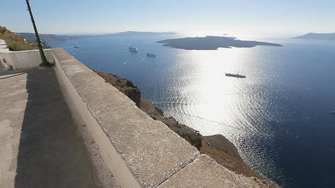 Happy male tourist enjoying view of sunlit islands and cruise vessels in sea Footage