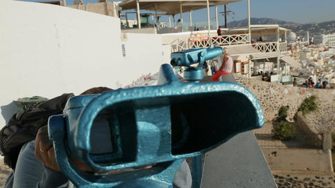Excited traveller viewing amazing seascape through binoculars, enjoying vacation Footage
