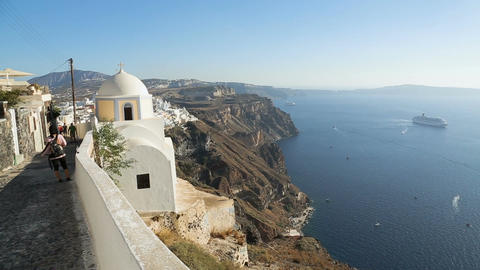 Tourists visiting Santorini churches, amazing aerial view of Aegean Sea, travel Live Action