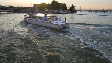 Motorboat carrying people down river at sunset, water traffic, transportation Footage