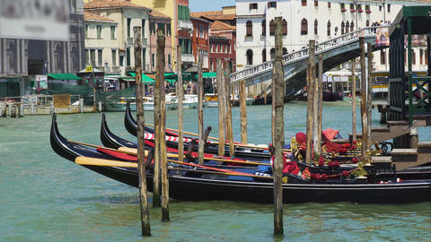 Beautiful gondolas docked in Venice canal, water transport, sightseeing tour Footage