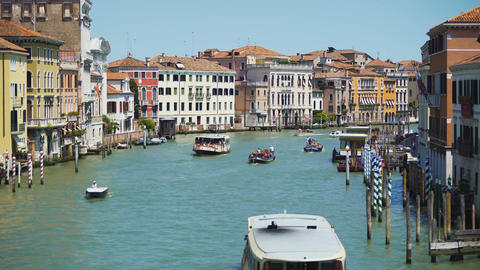 Tourists travel by vaporettos in Venice, beautiful view of Grand Canal, Italy Filmmaterial