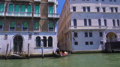 Tourists sailing on gondola, boat tour along Grand Canal in Venice, Italy sights Footage