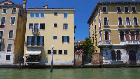 View of old beautiful houses from tour boat, summer vacations in Venice, travel Footage
