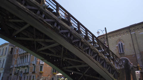 Boat sailing under bridge across Grand Canal, sightseeing tour to Venice, Italy Footage
