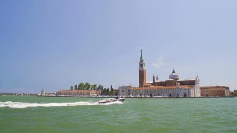 Motorboat sailing near beautiful San Giorgio Maggiore island in Venice, tourism Footage