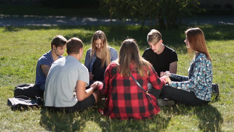 Young christians sitting in circle and praying Archivo
