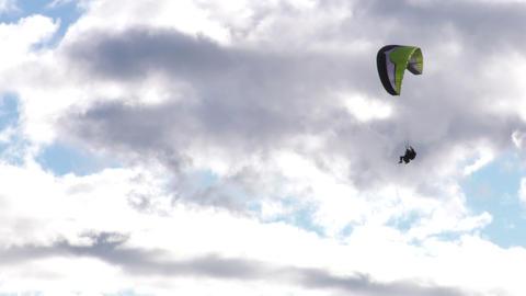 tandem paragliding tracking shot Footage