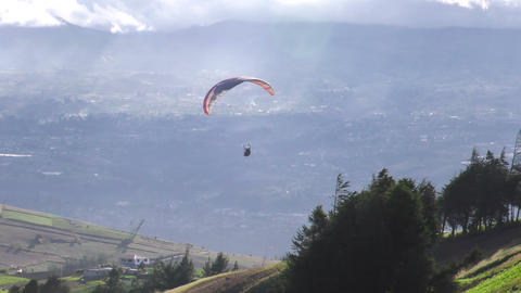 tandem paragliding flying over rural area in Andes Footage