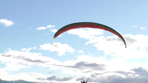 paraglide flight disappearing into the sunlight Footage