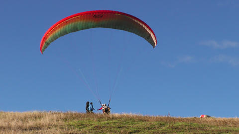 paraglide landing and collapses after successful flight Footage