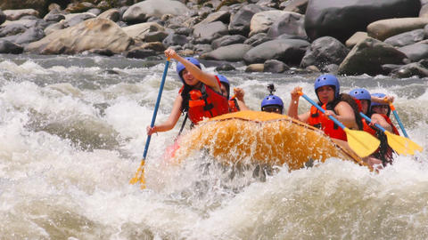 extreme whitewater rafting with young girls wearing bikinis Footage
