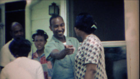 1969: Happy African family meeting outdoor home front porch Footage