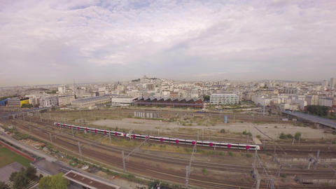Aerial view of TGV high speed train passing at Gare du Nord with Halle Pajol and Footage