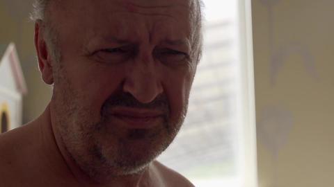Portrait Of Sad Senior Man Looking Footage