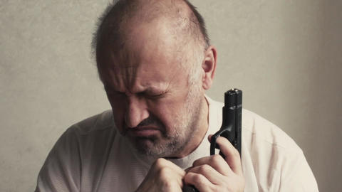 man with a gun suffers and cries despair Live Action