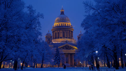 Tourists at night winter park against famous Saint Isaac's Cathedral Footage