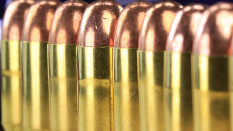 A row of 45 caliber ammunition copper plated bullets with brass slugs Footage