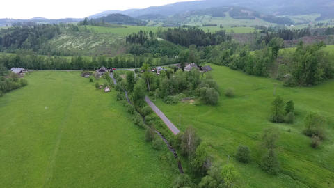 Aerial View. Panorama. Flight over a green grassy in mountains Footage
