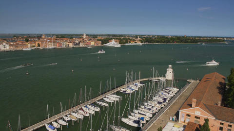 Ships and boats sailing along Venice canal, water transportation, moored yachts Footage