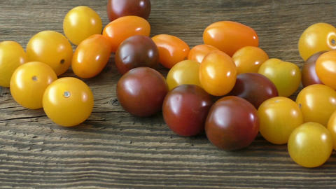 Cherry tomatoes on rustic wooden background Live Action