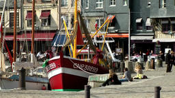 Europe France Normandy fishing village of Honfleur 006 red fishing boat & café Footage