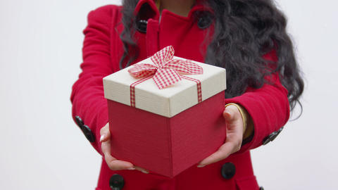 A box with a gift in the hands of a woman Footage