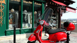 Europe France Normandy fishing village of Honfleur 017 red Italian scooter Filmmaterial