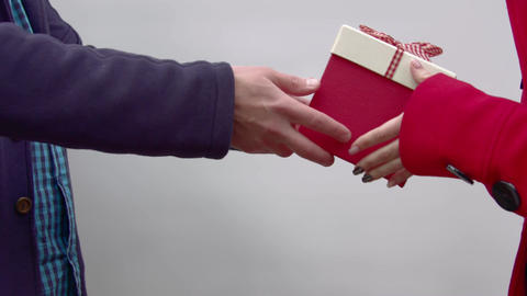 A girl takes a gift from the hands of a man Footage
