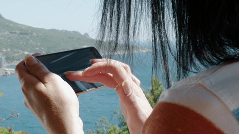 Woman Use A Smart Phone Mobile Technologies In Nature Image