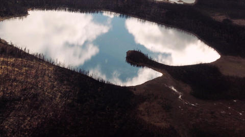 Alaskan Lakes with clouds reflections Live Action