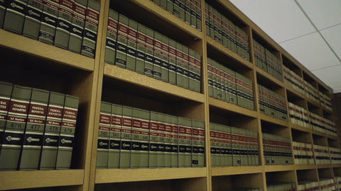 Legal books pan down in library Live Action