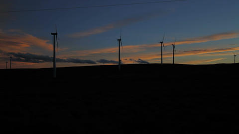 Wind Farm Silouette dark from the side after sunset Image