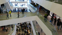 4K Ungraded: Visitors Walk on Floors of Spacious Shopping And Footage