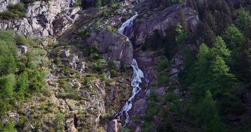 Alpine Watwerfall Aerial tracking Footage