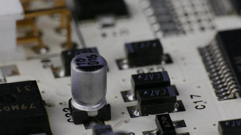4K Ungraded: Rotating White Printed Circuit Board, Microprocessors, Capacitors Footage