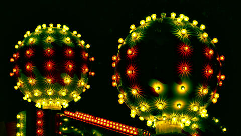 4K Attraction in Amusement Park With Abstract Cosmic Balls Flashes With Footage