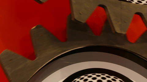 4K Ungraded: Decorative Metal Mechanical Gears Rotate Against Red Wall Footage