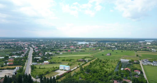 Aerial Drone View Of Small Town And Forest Landscape ビデオ