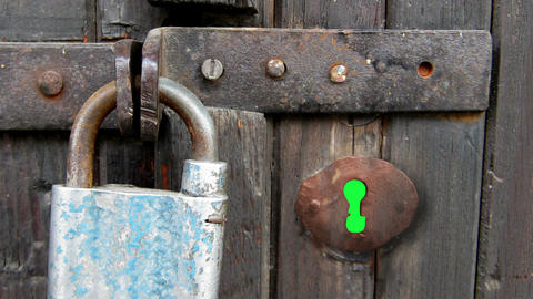 hole in wooden door with padlock and green screen from outside. Zoom in Animation