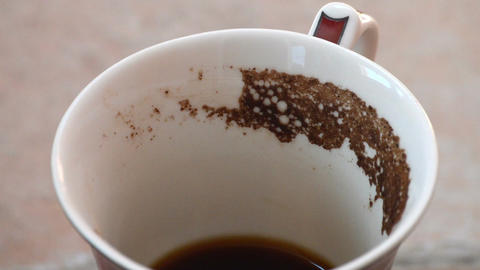 Guessing on the coffee grounds. Coffee mug with coffee grounds rotate .Close-up Footage