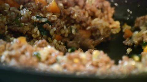 Mixed meat with vegetables frying in the pan close-up Footage