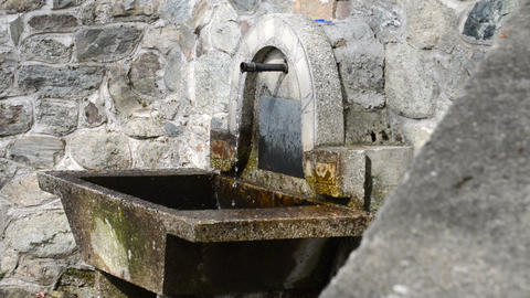 Clear and cold water flowing from metal pipe, fountain, water place, side view Footage