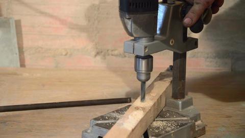hand drill boring a hole on a wood board Footage