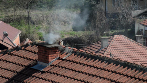 Smoke coming from chimney on house roof top Footage