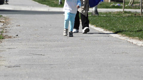 Closeup Of Mother And Little Boy Walking In The City Live Action
